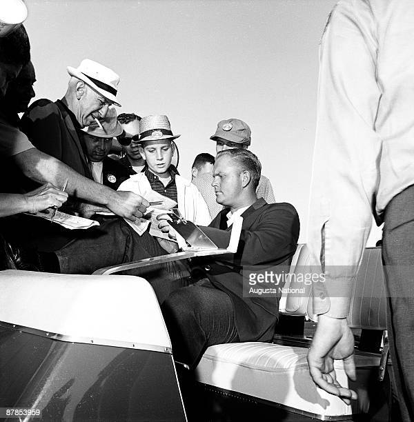 Masters Champion Jack Nicklaus signs autographs from the golf cart during the 1963 Masters Tournament at Augusta National Golf Club 0n April 7th 1963...