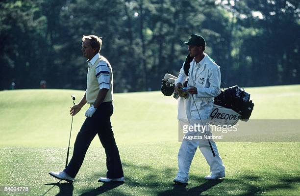Masters Champion Jack Nicklaus walks up the green with his caddie during the 1990 Masters Tournament at Augusta National Golf Club on April 1990 in...