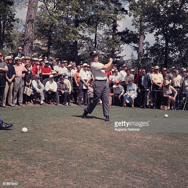 Masters Champion Jack Nicklaus watches his tee shot in front of a small gallery during the 1963 Masters Tournament at Augusta National Golf Club on...