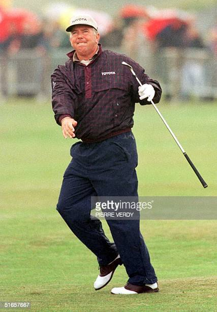 Masters champion Mark O`Meara is delighted with a shot from the fairway on the 18th hole 14 July during the practice round for the 127th Open Golf...