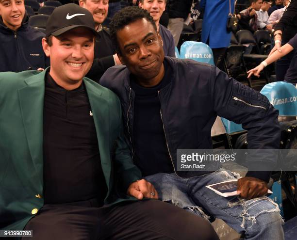Masters Champion Patrick Reed and comedian Chris Rock pose for a photo during the New York Knicks and Cleveland Cavaliers basketball game during the...