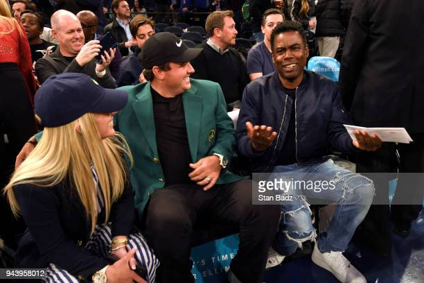 Masters Champion Patrick Reed and his wife Justine are visited by comedian Chris Rock during the New York Knicks and Cleveland Cavaliers basketball...