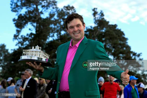 Masters Champion Patrick Reed celebrates with the Masters Tournament Trophy during Green Jacket Presentation Ceremony following the Final Round of...