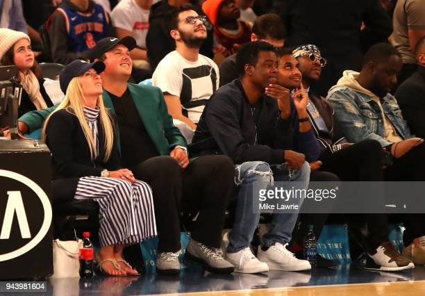 Masters Champion Patrick Reed looks on with wife Justine comedian Chris Rock comedian Aziz Anzari and rapper 2 Chainz during the game between the New...