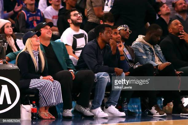 Masters Champion Patrick Reed , looks on with wife Justine, comedian Chris Rock, comedian Aziz Anzari and rapper 2 Chainz during the game between the...
