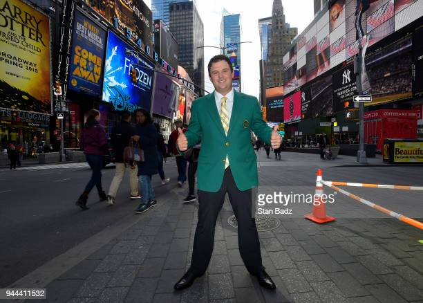 Masters Champion Patrick Reed stands in Times Square during the Masters Champion media tour throughout New York City on April 9 2018 in New York City...