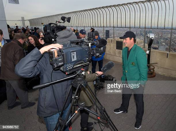 Masters Champion Patrick Reed talks to a TV reporter at the Empire State Building during the Masters winner media tour throughout New York City on...