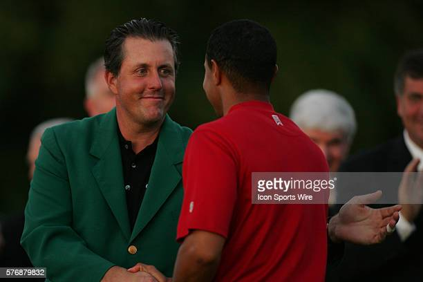 Masters champion Phil Mickelson left congratulates Tiger Woods after Woods wins his fourth Masters and ninth major championship