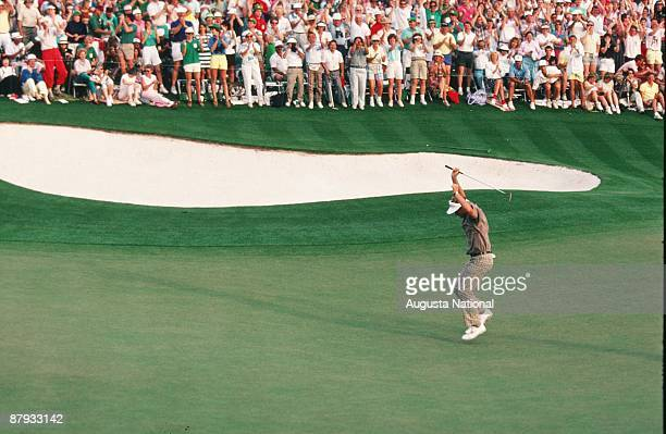Masters Champion Sandy Lyle reacts to his winning putt on the 18th green in front of a large gallery during the 1988 Masters Tournament at Augusta...