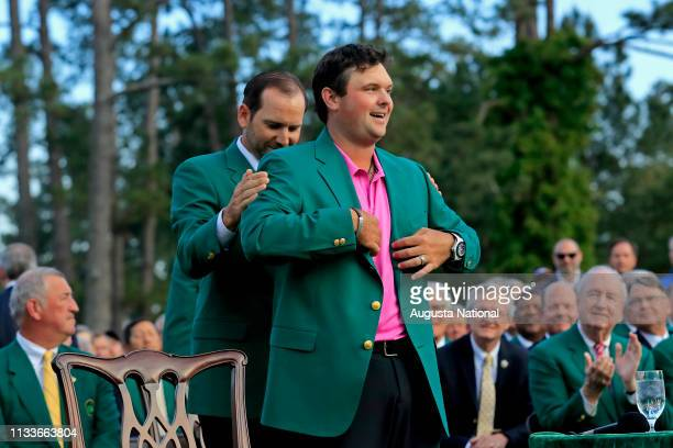 Masters champion Sergio Garcia of Spain presents the Green Jacket to 2018 Masters Champion Patrick Reed during Green Jacket Presentation Ceremony...