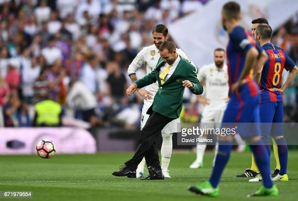 Masters champion Sergio Garcia performs a honorary kick off alongside Sergio Ramos of Real Madrid prior to the La Liga match between Real Madrid CF...