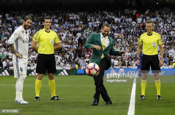 Masters champion Sergio Garcia performs a honorary kick off prior to the La Liga match between Real Madrid and FC Barcelona at Estadio Santiago...