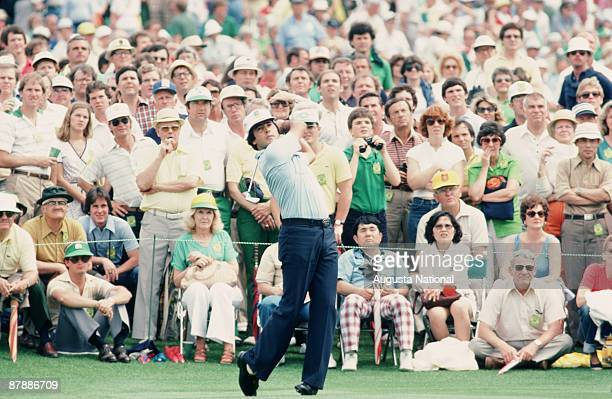 Masters Champion Seve Ballesteros watches tee shot in front of a large gallery during the 1980 Masters Tournament at Augusta National Golf Club in...