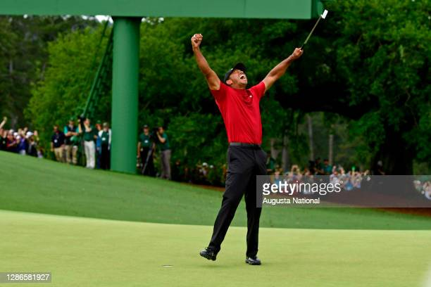 Masters champion Tiger Woods celebrate safter Tiger made his putt on hole No. 18 to win the Masters during the final round of the Masters at Augusta...