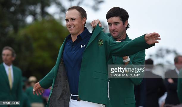 Masters defending champion Bubba Watson places the Green Jacket on 2015 Champion Jordan Spieth at the 79th Masters Golf Tournament at Augusta...