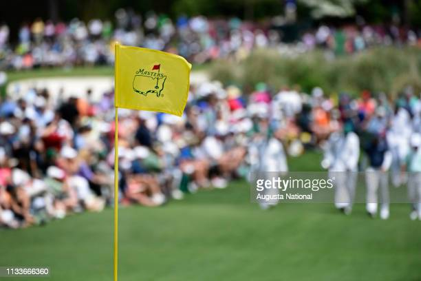 Masters flagstick unfurls during the Par 3 Contest at Augusta National Golf Club, Wednesday, April 4, 2018.