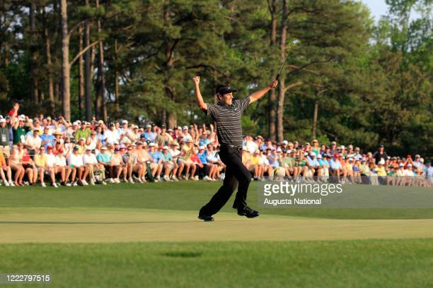 Masters participant Charl Schwartzel of South Africa reacts on the birdie putt at No. 18 to win the 2011 Masters Tournament at Augusta National Golf...