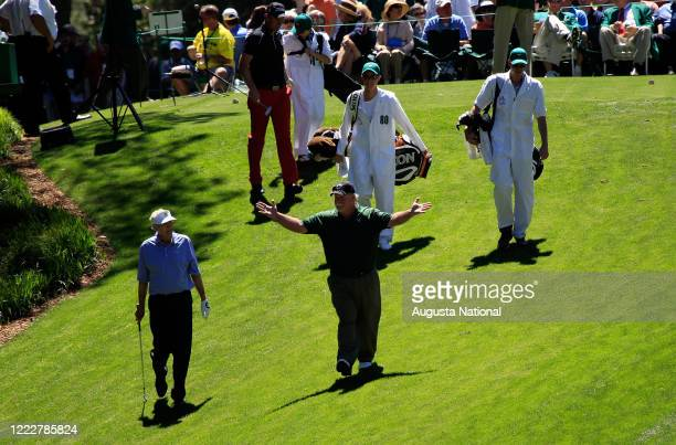Masters participant Craig Stadler, center, of the United States celebrates his hole-in-one on No. 1 at the Par 3 Contest for the 2011 Masters...