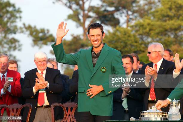 Masters Tournament winner Charl Schwartzel of South Africa waves at the Green Jacket ceremony after the final round of the 2011 Masters Tournament at...