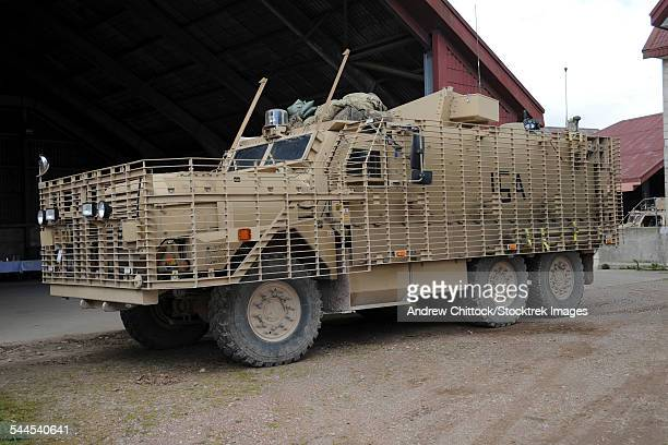 a mastiff 6x6 armored patrol vehicle of the british army. it is suitable for road patrols and convoys. - mine resistant ambush protected stock pictures, royalty-free photos & images