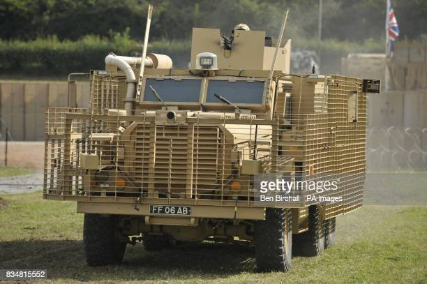 A Mastiff 6x6 wheel drive patrol vehicle with body armour in the form of heavy duty metal grids that cause antitank weapons to detonate further from...