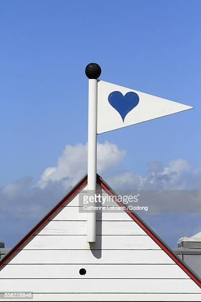 mast-shaped flag with a blue heart. - belgische cultuur stockfoto's en -beelden