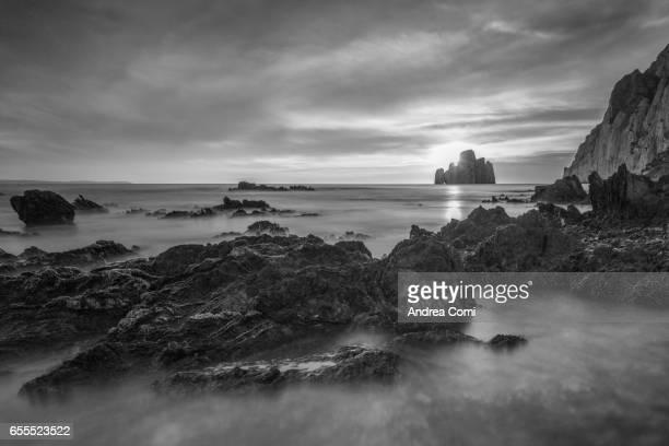 masua beach, sardinia, italy, europe. pan di zucchero in the background - cerdeña fotografías e imágenes de stock