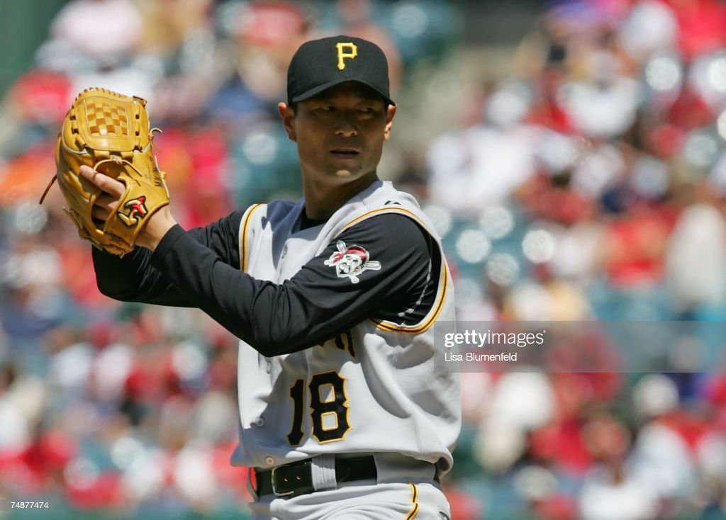 Masumi Kuwata #18 of the Pittsburgh Pirates pitches in the seventh inning against the Los Angeles Angels of Anaheim at Angels Stadium June 24, 2007 in Anaheim, California.