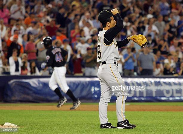 Masumi Kuwata of the Pittsburgh Pirates reacts after surrendering a two run home run against Lastings Milledge of the New York Mets during their game...