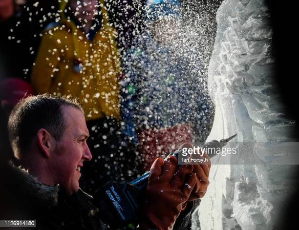 Mat Foster from Glacial Art carves a phoenix from ice during an event celebrating the theme myths and legends at the biggest outdoor ice trail in the...