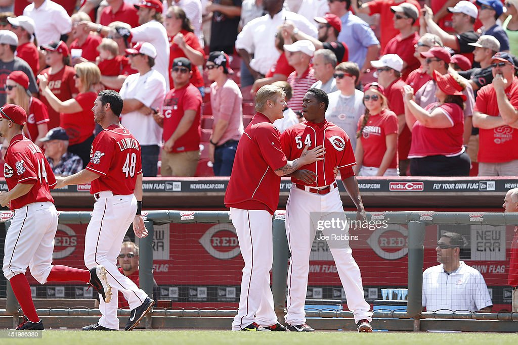 Mat Latos #55 of the Cincinnati Reds restrains Aroldis Chapman #54 after a scuffle following the top of the tenth inning in the game against the Chicago Cubs at Great American Ball Park on July 10, 2014 in Cincinnati, Ohio. The Cubs won 6-4 in 12 innings.