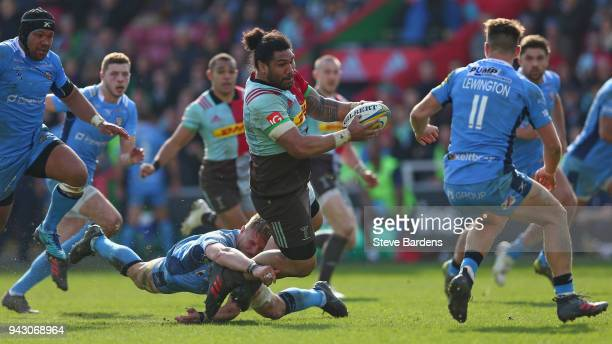 Mat Luamanu of Harlequins is tackled by Max NorthcoteGreen of London Irish defence during the Aviva Premiership match between Harlequins and London...