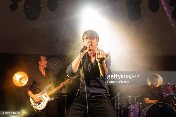 Mat Osman, Brett Anderson and Simon Gilbert of Suede perform on stage at Kelvingrove Park on July 31, 2019 in Glasgow, Scotland.