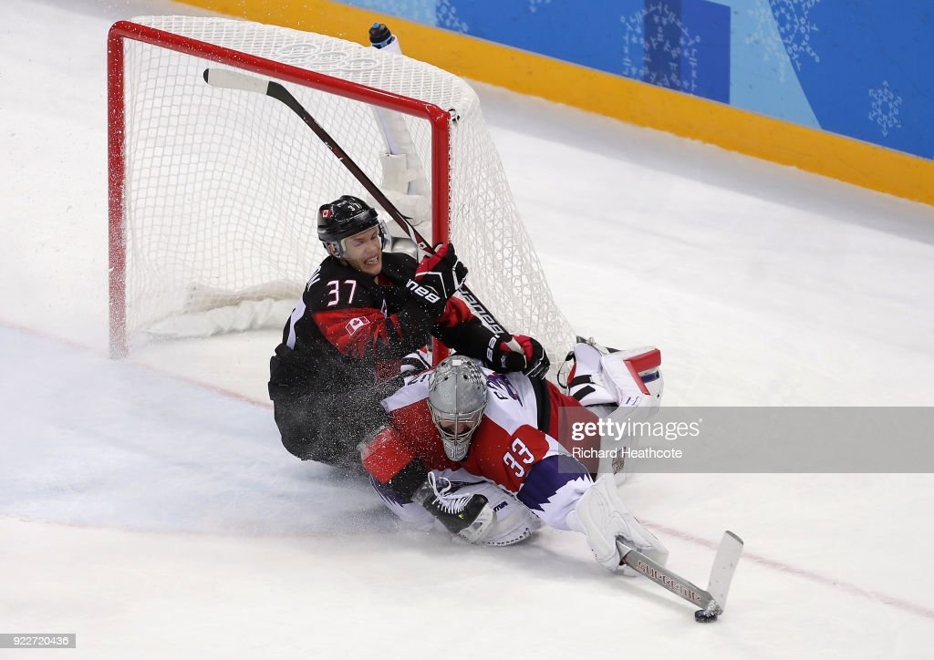 Mat Robinson #37 of Canada collides with Pavel Francouz #33 of the Czech Republic in overtime during the Men's Ice Hockey Preliminary Round Group A game on day eight of the PyeongChang 2018 Winter Olympic Games at Gangneung Hockey Centre on February 17, 2018 in Gangneung, South Korea.