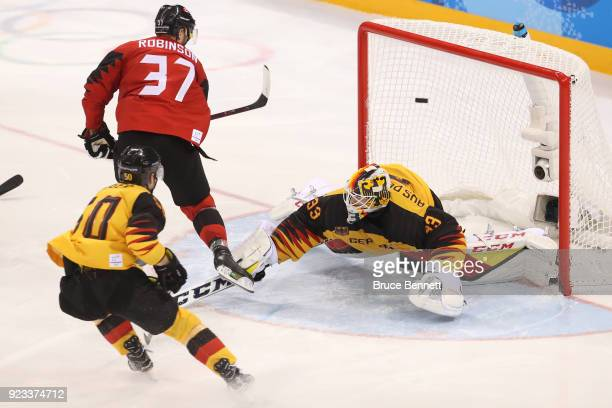 Mat Robinson of Canada scores a goal on Danny Aus Den Birken of Germany in the third period during the Men's Playoffs Semifinals on day fourteen of...