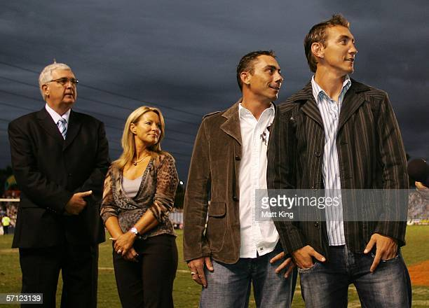 Mat Rogers Don Rogers Ingrid Rogers and Barry Pierce watch a tribute to the late Steve Rogers prior to the round two NRL match between the...