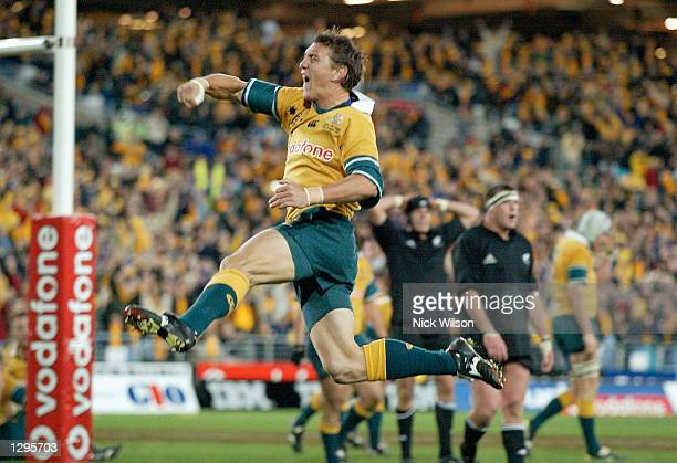 Mat Rogers of the Wallabies celebrates scoring a try in the last minutes of the Tri Nations Rugby Union test match between Australia and New Zealand...