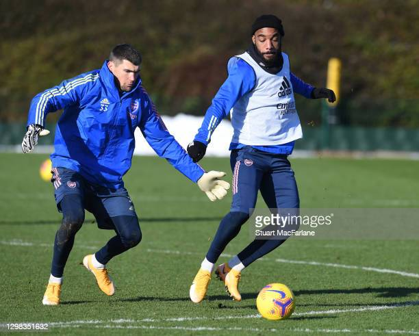 Mat Ryan and Alex Lacazette of Arsenal during a training session at London Colney on January 25, 2021 in St Albans, England.