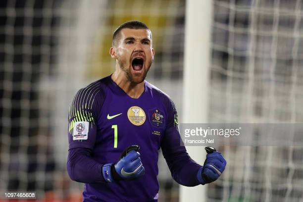 Mat Ryan of Australia celebrates after saving the fourth penalty from Marat Bikmaev of Uzbekistan in the penalty shoot out during the AFC Asian Cup...