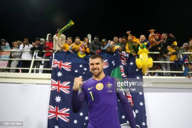 Mat Ryan of Australia celebrates with fans following his side's win after a penalty shootout in the AFC Asian Cup round of 16 match between Australia...