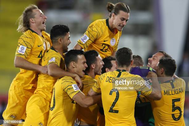 Mat Ryan of Australia celebrates with his teammates following their sides win after a penalty shootout in the AFC Asian Cup round of 16 match between...