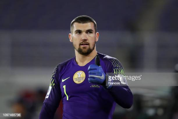 Mat Ryan of Australia reacts in the penalty shoot out during the AFC Asian Cup round of 16 match between Australia and Uzbekistan at Khalifa Bin...