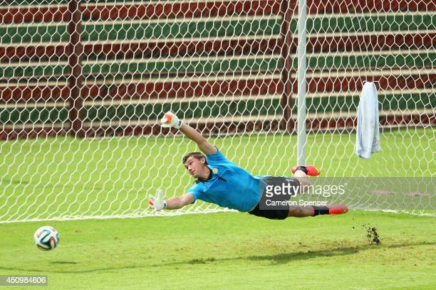 Mat Ryan of the Socceroos goalkeeps during an Australian Socceroos training session and press conference at Arena Unimed Sicoob on June 21 2014 in...