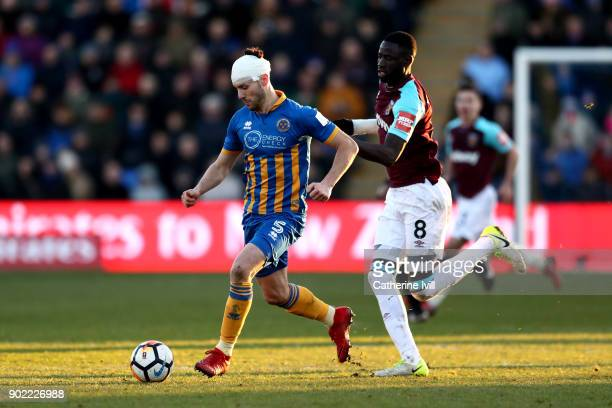 Mat Sadler of Shrewsbury Town and Cheikhou Kouyate of West Ham United battle for the ball during The Emirates FA Cup Third Round match between...