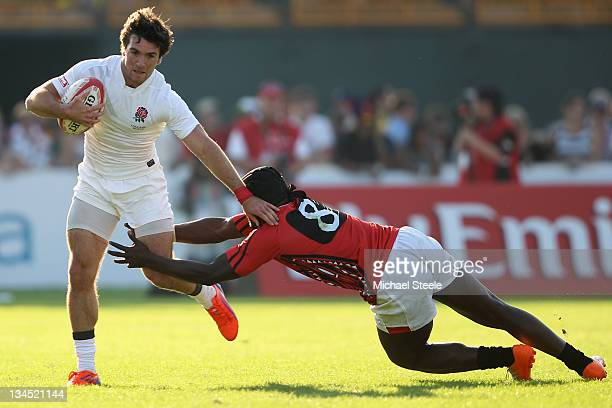 Mat Turner of England avoids the challenge from Horace Otieno of Kenya during the match between England and Kenya on Day Two of the IRB Dubai Sevens...