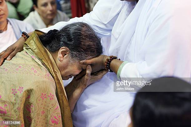 Mata Amritanandamayi also known as 'The Hugging Saint' blesses a follower on July 10 2012 in New York City The Hindu spiritual leader and guru is on...