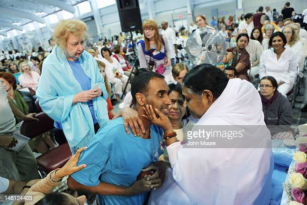 Mata Amritanandamayi also known as 'The Hugging Saint' embraces followers on July 10 2012 in New York City The Hindu spiritual leader and guru is on...