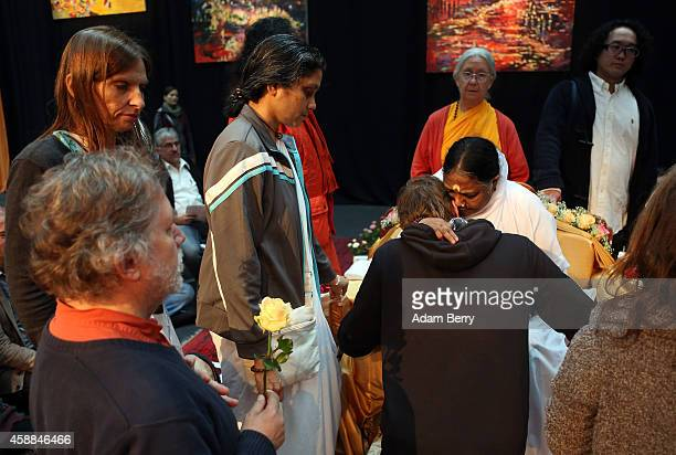 Mata Amritanandamayi Devi primarily known simply as Amma the hugging saint hugs devotees in the event hall Arena on November 12 2014 in Berlin...