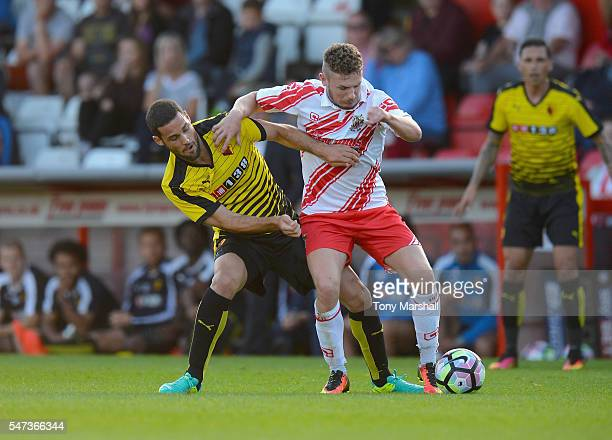Mata Mario Suarez of Watford tackles Dale Gorman of Stevenage during the PreSeason Friendly match between Stevenage and Watford at The Lamex Stadium...