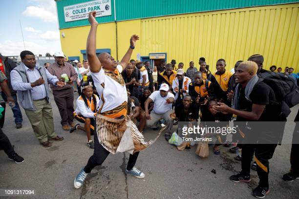 Matabeleland fan dances in front of singing team members after their 50 loss to Szekely Land in the Conifa World Football Cup 2018 at Coles Park...